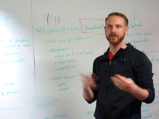 Services Consultant Matt Mickle presents insights to the Product team